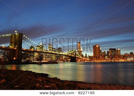 New York City Skyline at night from across the East River. poster