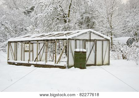 Snowy Plastic Greenhouse Hothouse In Midwinter Farm Garden