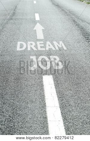 Text Dream Job with arrow marking on road surface