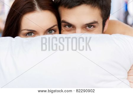 Hiding Their Faces Behind The Pillow.