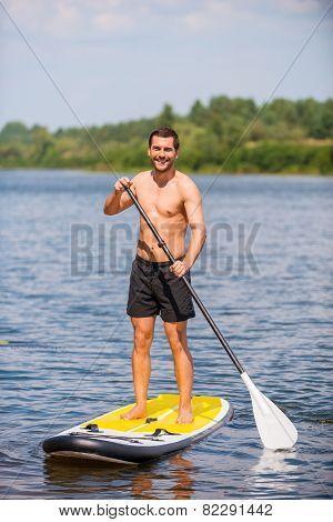 Man On Paddleboard.