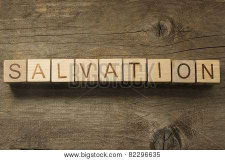 Salvation wooden text on a wooden background