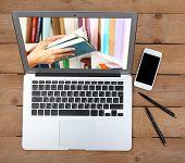 E-learning concept.  Digital library - books inside laptop poster