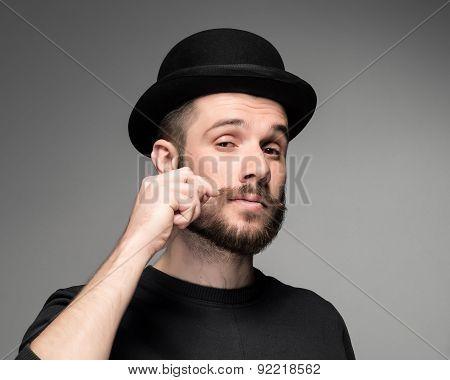 Young attractive macho stylish fashionable guy.