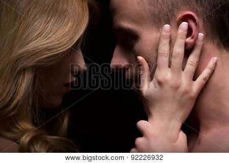Portrait of sensual passionate couple looking at eyes poster