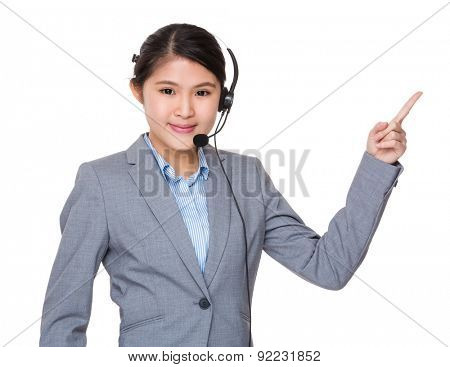 Asian businesswoman with headset and finger point up