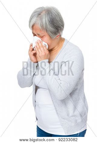 Senior woman sneeze
