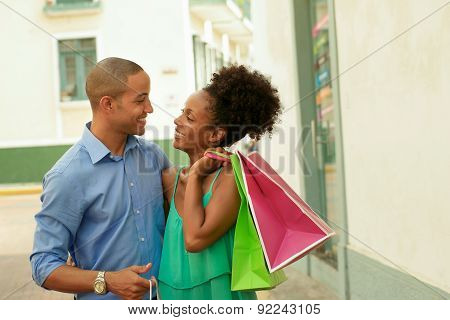 African American Couple Carrying Shopping Bags In Panama City