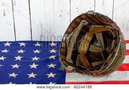 Wwii Helmet On American Flag