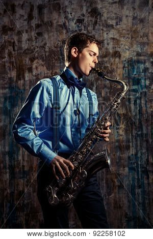 Young expressive musician playing the saxophone. Art and music. Jazz music. poster