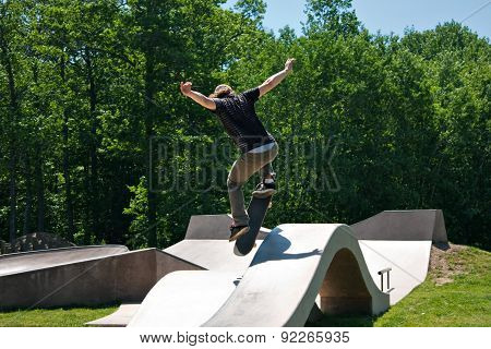 Skateboarder Jumping Skate Ramp