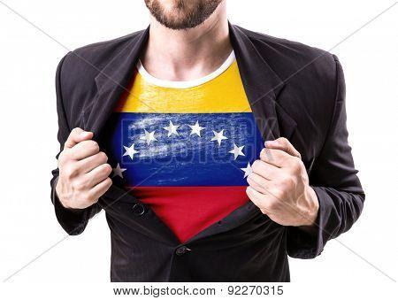 Businessman stretching suit with Venezuela flag on white background