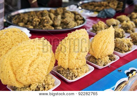 """Thai dessert called """"Khao Mao Tod"""" Deep-fried Bananas with Coconut. poster"""