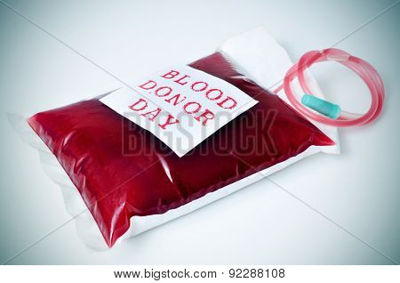 closeup of a blood bag with a sticker with the text blood donor day