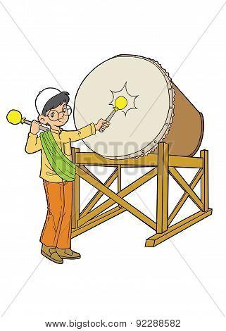Muslim boy playing big drum
