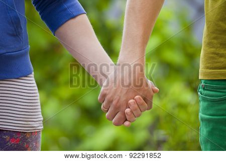 Loving Couple Holding Hands