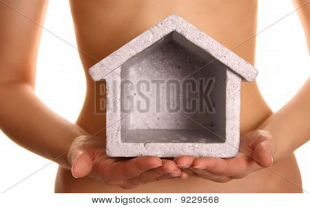 woman holding a house