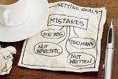 common mistakes in setting goals (too many, too big, not specific, not written) - a sketch drawing on a cocktail napkin with a coffee cup poster