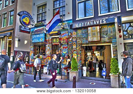 AMSTERDAM, NETHERLANDS - MAY 5, 2016: Cityscape with people and the Bulldog coffeeshop in Amsterdam, Netherlands. HDR image selective focus
