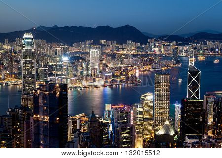 Colorful night scene of Victoria Harbor in Hong Kong just after sunset at the blue hour. Shot taken at Victoria Peak overlooking Tsim Sha Tsui in Kowloon.