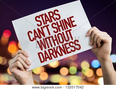 Stars Cant Shine Without Darkness placard with bokeh background