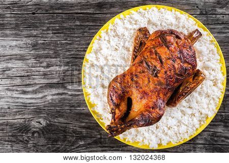 Roasted Whole Duck in honey mustard soy glaze with rice close-up