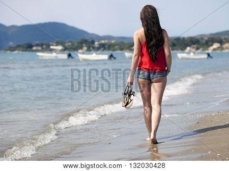 Woman Walking On Sandy Beach Laganas Zakynthos Greece