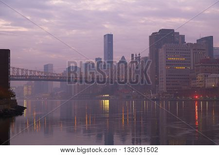 The foggy Manhattan in early morning. View of Queensboro Bridge and Manhattan from Roosevelt Island.