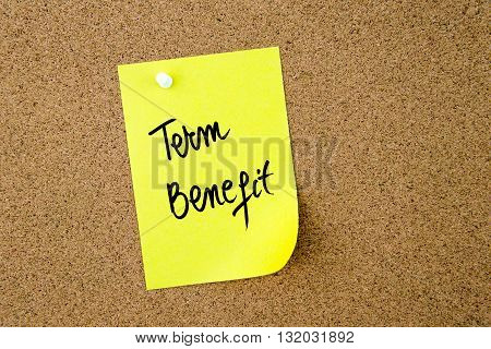 Term Benefit Written On Yellow Paper Note