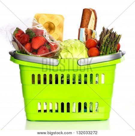 Supermarket basket full with grocery products isolated on white background