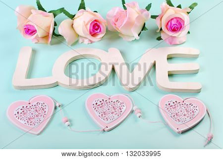 romantic love background in pastel colors with word lovehearts and roses