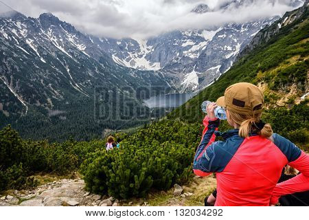 Woman Drinking Mineral Bottled Water On Mountain Track