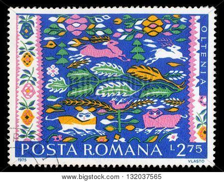 ZAGREB, CROATIA - JULY 18: a stamp printed in Romania shows Romanian Peasant Rugs, Oltenia, circa 1975, on July 18, 2014, Zagreb, Croatia