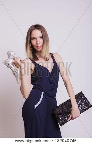 Fashion Woman With Leather Handbag And High Heels.