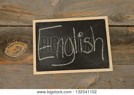 English written in chalk on a chalkboard on a rustic background