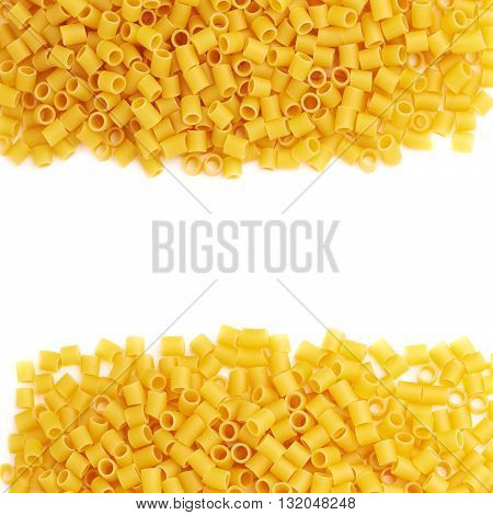 Set of pile of dry ditalini yellow pasta over isolated white background, different foreshortenings