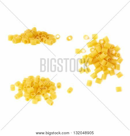 Pile of dry ditalini yellow pasta over isolated white background