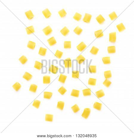 Single pieces of dry ditalini yellow pasta over isolated white background