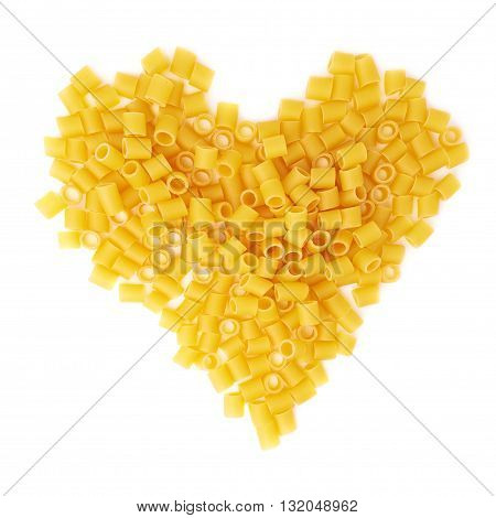 Heart shape made of dry ditalini yellow pasta over isolated white background