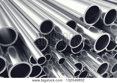 Heap of shiny metal steel pipes with selective focus effect, 3d illustration