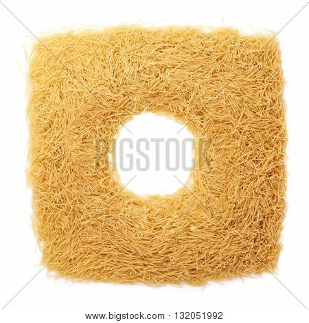 Round frame made of dry noodles yellow pasta over isolated white background