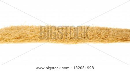 Line made of dry noodles yellow pasta over isolated white background