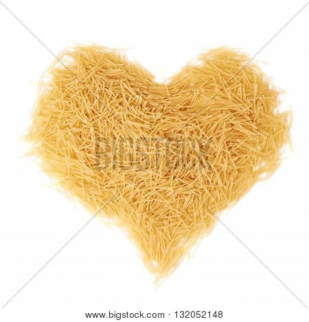 Heart shape made of dry noodles yellow pasta over isolated white background
