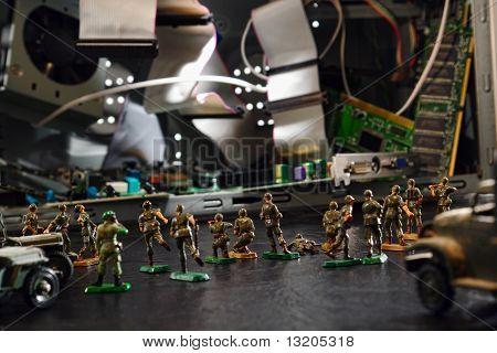 Computador sob ataque de hackers por soldados de brinquedo
