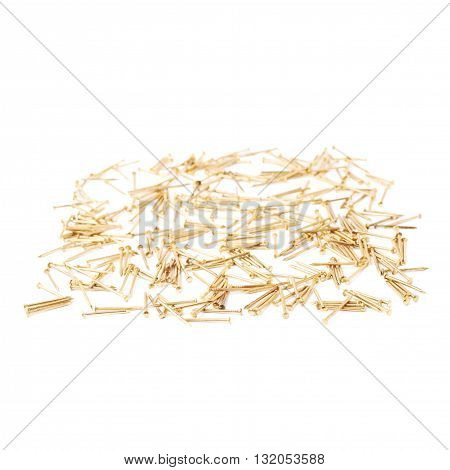 Scattered metal nails over surface isolated over white background