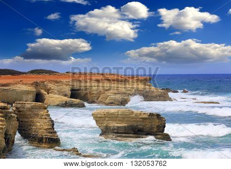 Landscape with rocks in sea at stormy day