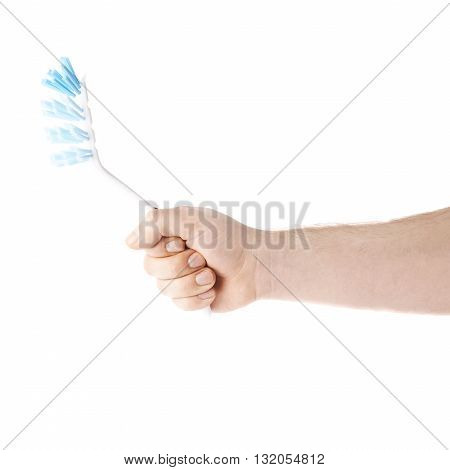 Caucasian male hand holding a dish brush, composition isolated over the white background