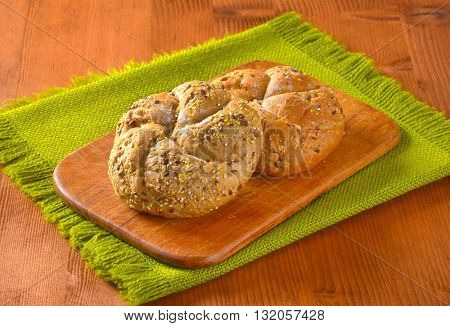 two fresh buns on wooden cutting board