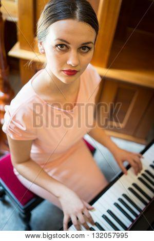 Beautiful girl on piano