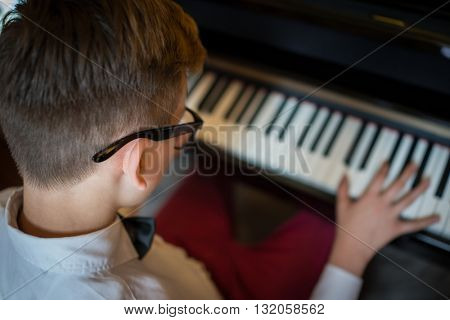 Handsome young men playing piano and making music